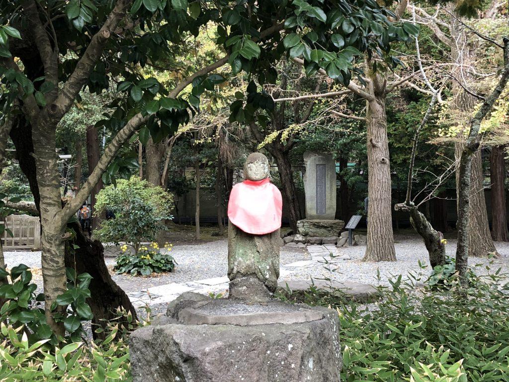 A faded statue of Jizo.