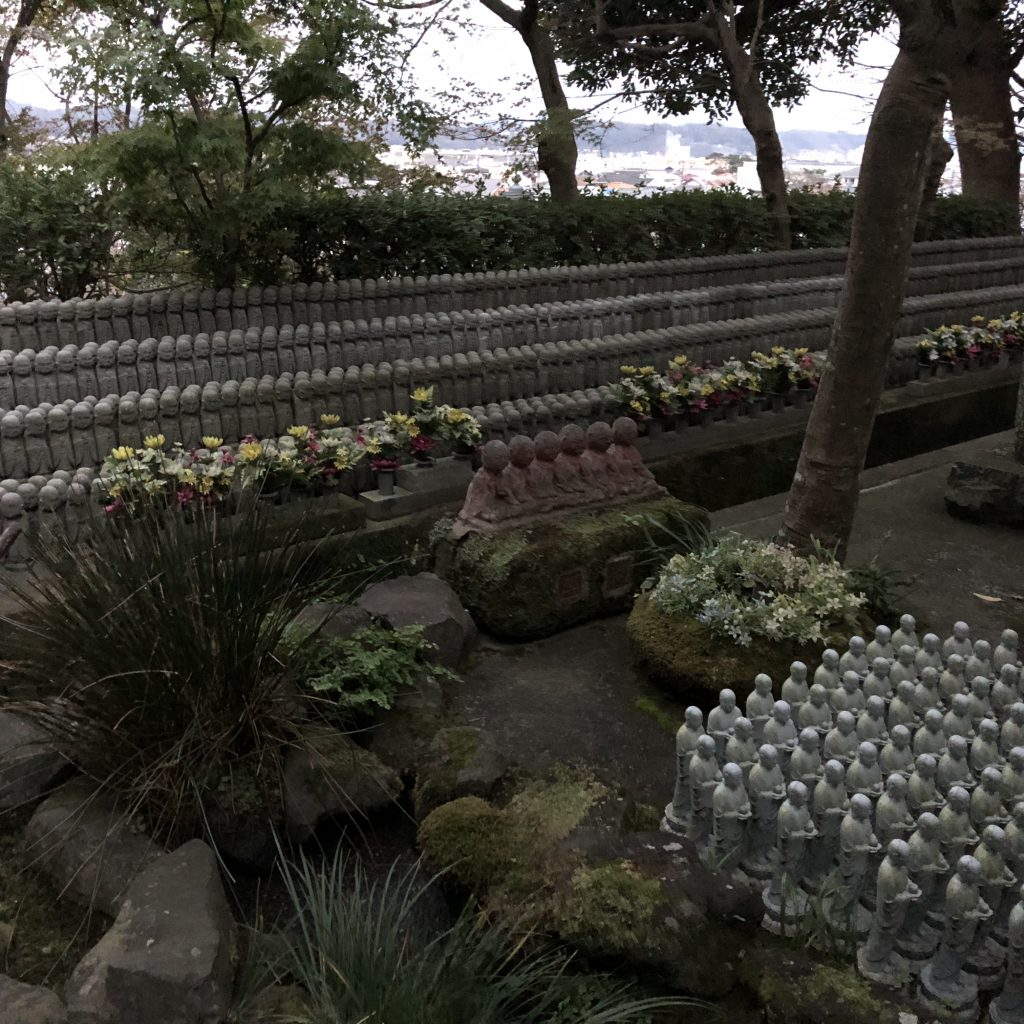 Another part of the memorial garden. Hundreds of Jizo statues line the edges.