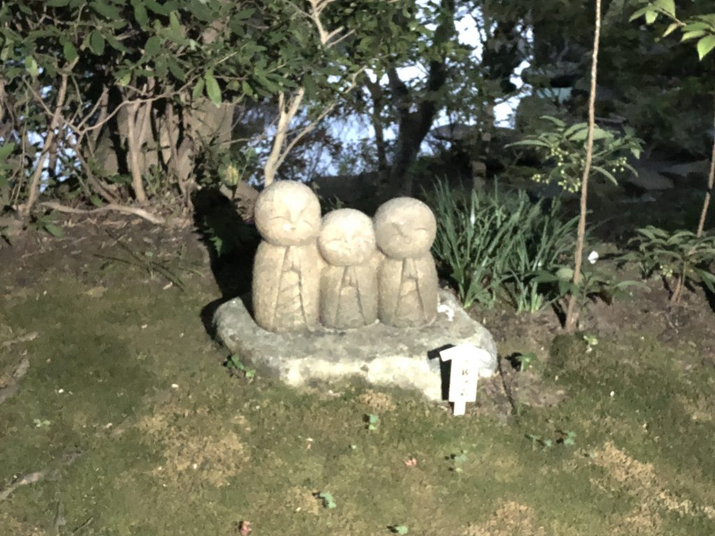 Three little Jizo, similar in style to Nagomi Jizo. The picture is a little blurry due to the lighting.