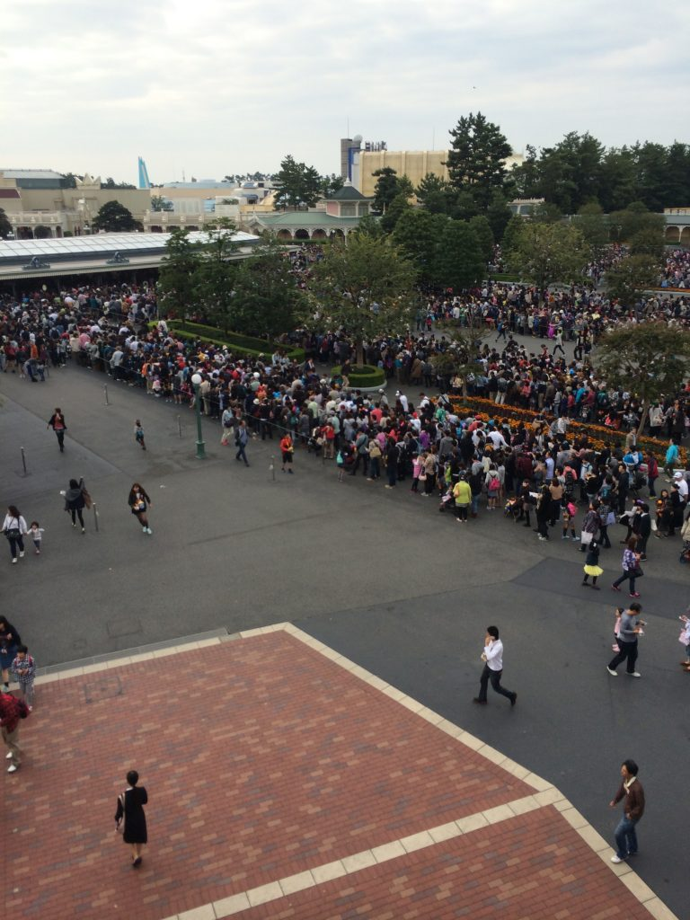 Hundreds of people lined up outside the park waiting to get in.