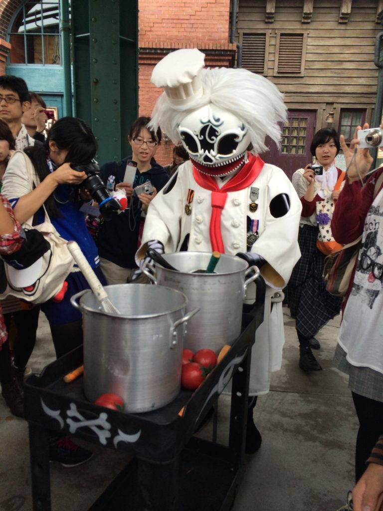 A Dia de los Muertos inspired character dressed up like a chef walking around Tokyo DisneySea.