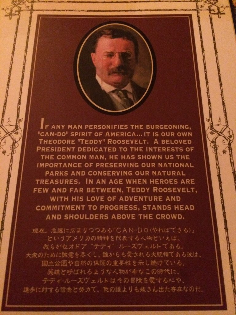 A sign extolling the virtues of American President Teddy Roosevelt. It's in English first, then Japanese.