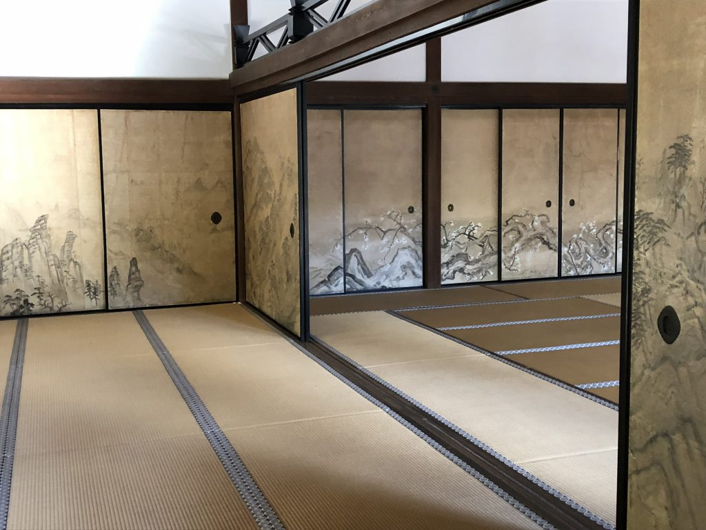 A glimpse inside the temple. Though it's a simple tatami room, the screens are painted with scenes of mountains and trees.