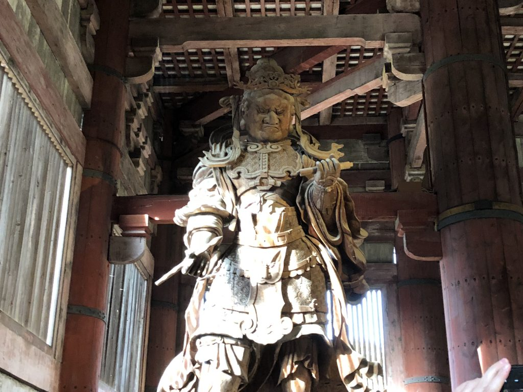 A huge statue of a guardian king.