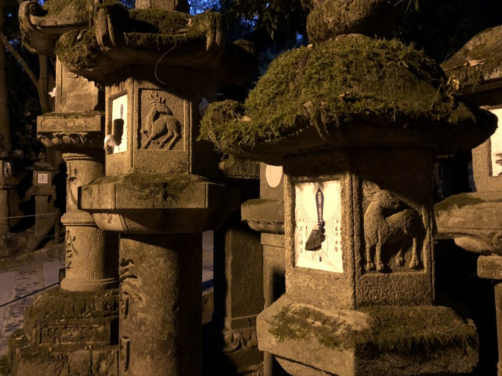 Stone lanterns with deer carved into them.